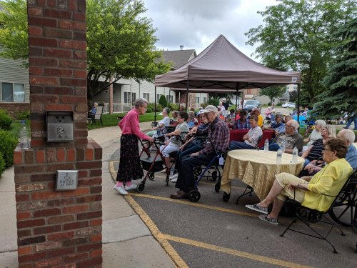 Primrose Mankato residents converse as they wait for the Riverblenders to fill the air with Harmony at the birthday party.