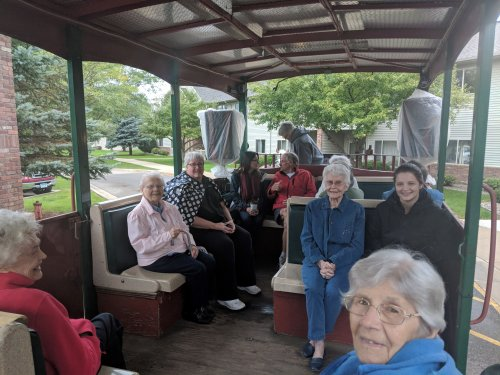 Staff accompany residents on a fun horse & trolley ride around the park!