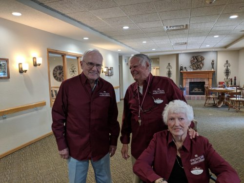 'Welcome - come on in!' Ambassadors Don O., Pat and Ken T. proudly show off their new shirts and their hospitality.