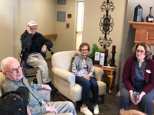 Residents reminiscing with Lora, talking about the time an airplane flew under the bridge in Mankato many years ago!