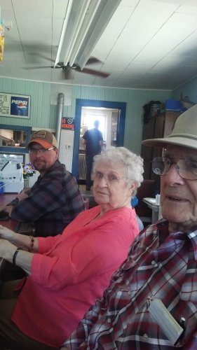 At the pie shop - Don, Norma, and maintenance tech, Alan K. wait at the counter for the succulent homemade pie!