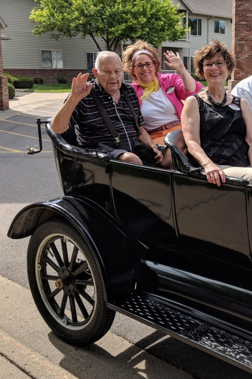 Executive Director Lori, Lora B. and Ernie P. roll back to the early 30s in this Model A.