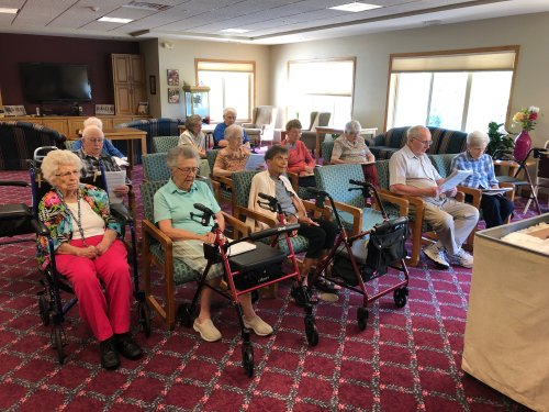 Residents singing songs during our chapel service.