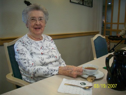 Primrose Resident, Vernice, is enjoying her afternoon chatting with friends and drinking some tea.