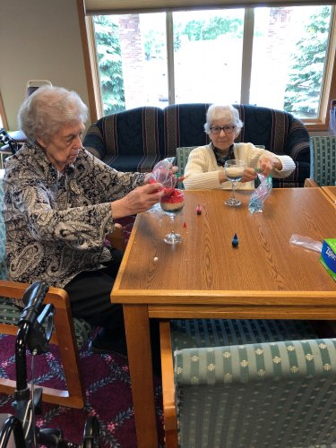 Mary Ann and Jeanne enjoying their time creating their Fourth of July craft!