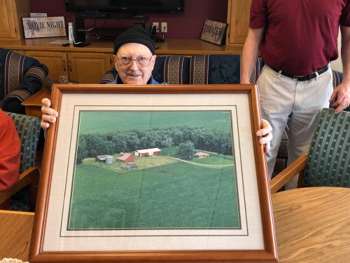 Jim showing off an aerial photograph of his farm for our Growing up on the Farm Photo Reminisce event!