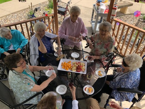 The women are out on this beautiful day enjoying the company of each other and some wine!