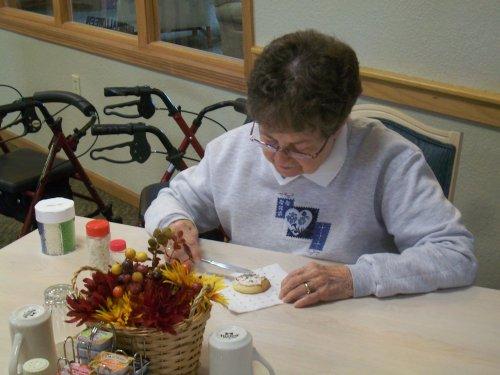 Resident, Monica, decorating cookies!