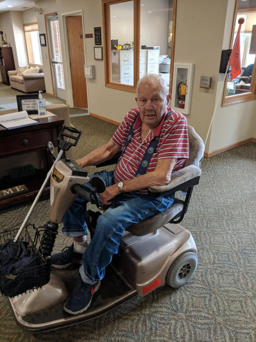Resident Ernie scooting around after enjoying the weather outdoors!