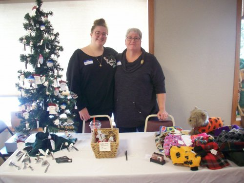 Our Director of Dining, Lora, and Administrative Assistant, Mary, showcasing their hobbies outside of work at our first annual Holiday Showcase!