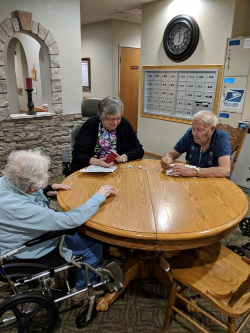 Residents enjoy the afternoon while engaging their minds playing Yahtzee!