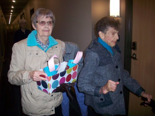 Marilyn and Betty preparing themselves to surprise an unsuspecting child with a May Day basket!