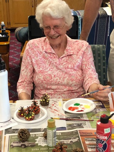 Betty enjoying our fall craft with a little laughter too!