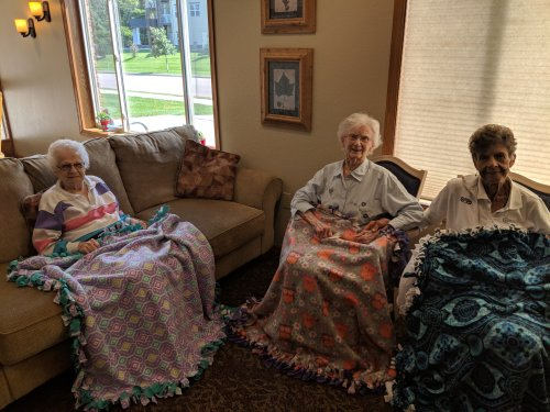 Residents enjoy their new blankets that were donated by a student from Iowa.