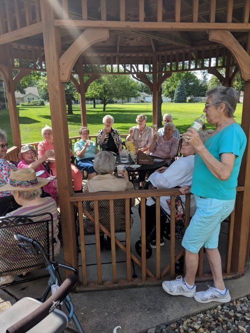 Residents enjoy a beverage during Big Band Happy Hour hosted by our Sales Director, Lora B.