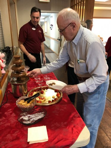 Don gathering goodies to dip into the chocolate fountain during our Valentine's Day Party!