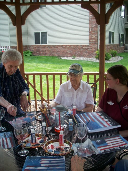 Mary Ann and Norma enjoy some wine during our painting class with our Life Enrichment Coordinator, Jenna.