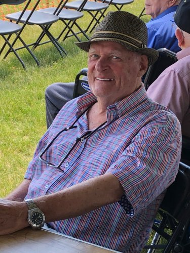Ken enjoying himself as he waits patiently for the United States Air Force Thunderbirds to perform at the Minnesota Air Spectacular.