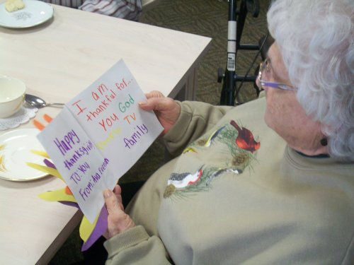 Jane enjoys reading a card she received from a local elementary school student.