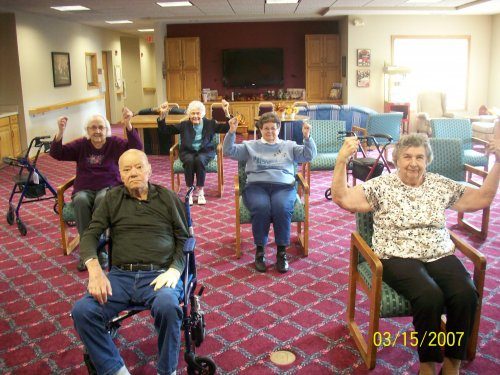 Primrose residents showing off how strong they have become through our strength and balance classes!
