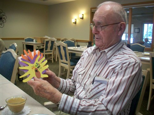 Don admiring the his hand crafted card that he received from a local elementary school student.
