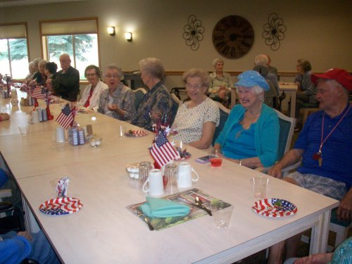 Residents gather to celebrate the Fourth of July with a festive red, white, and blue party!