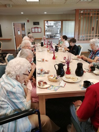 Residents enjoying a delicious tea hosted by our Director of Dining, Alison!