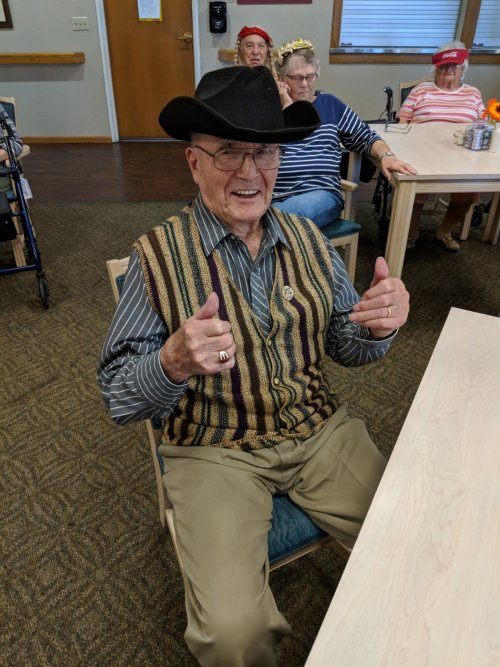 Don enjoying the entertainment in his cowboy hat! He seems to be always smiling about something!