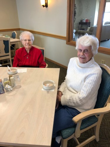 Residents Doris and Betty posing for a picture after enjoying their fruit cocktail!