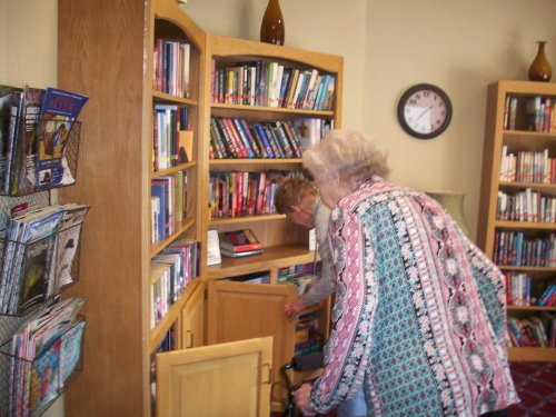 Joy and Mary Ann searching high and low to find their next clue and prize during our St. Patrick's Day Scavenger Hunt!