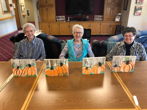 Mary Ann, Mary, and Monica had a grand time painting pumpkins!
