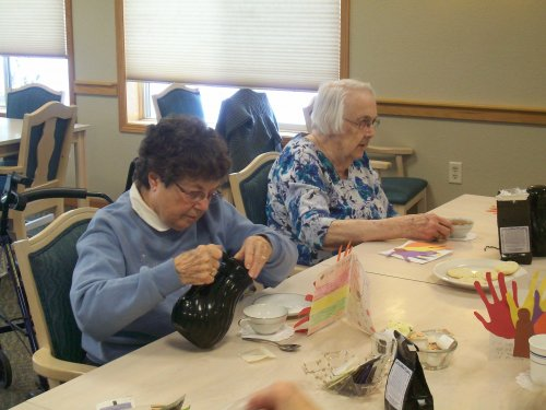 Residents Monica and Gennie enjoy some afternoon tea and cookies!