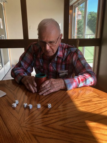 Don counting his dice playing Farkle.