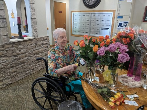 Irene enjoys arranging donated flowers for our residents.