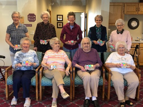 Residents showing off their Easter eggs after coloring them during an activity!