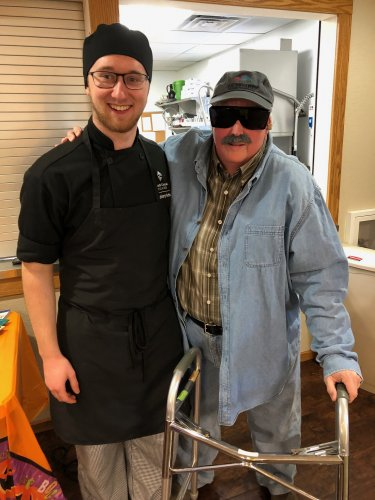 Avery dressed as the Remy from Ratatouille and Henry, a prospect, is secretly our Director of Dining, Lora, in disguise! The residents didn't recognize her at all!