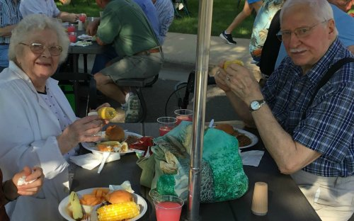 Residents Ed and Lilli enjoy their homecooked meal at our family picnic!