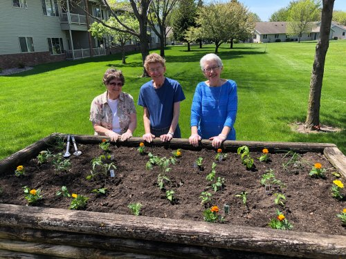 Monica, Joy, and Mary stand proud behind the Primrose Community Garden that they helped plant!