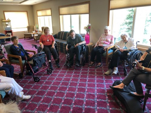 Residents enjoy sing-along during Music Therapy.