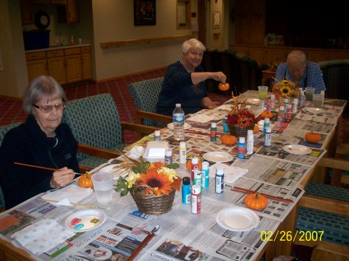 Residents Marilyn, Aileen, and Ernie enjoying their time painting mini pumpkins during our fall festival! Their pumpkins turned out great!