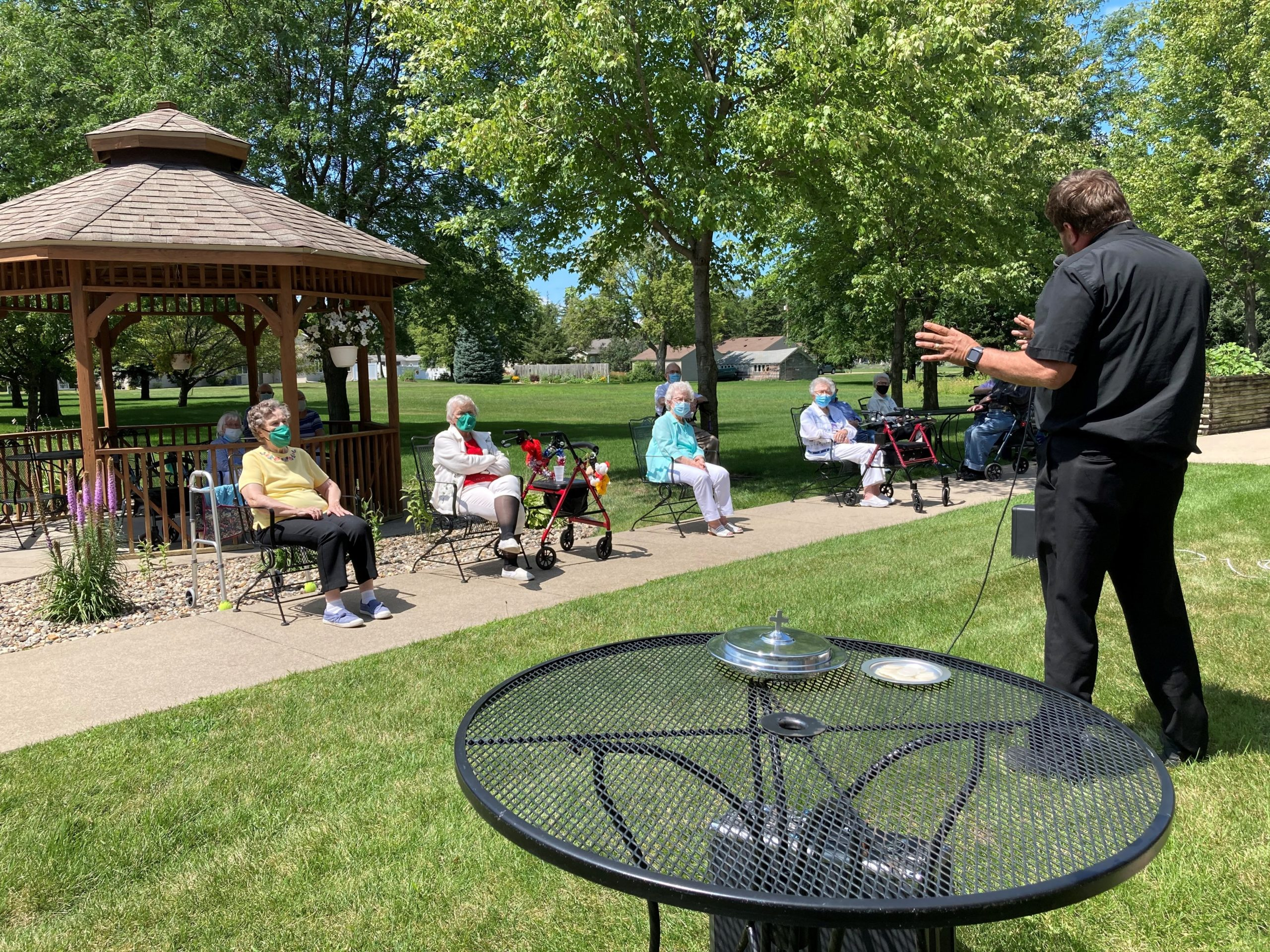 Communion for our residents out in our beautiful Courtyard.