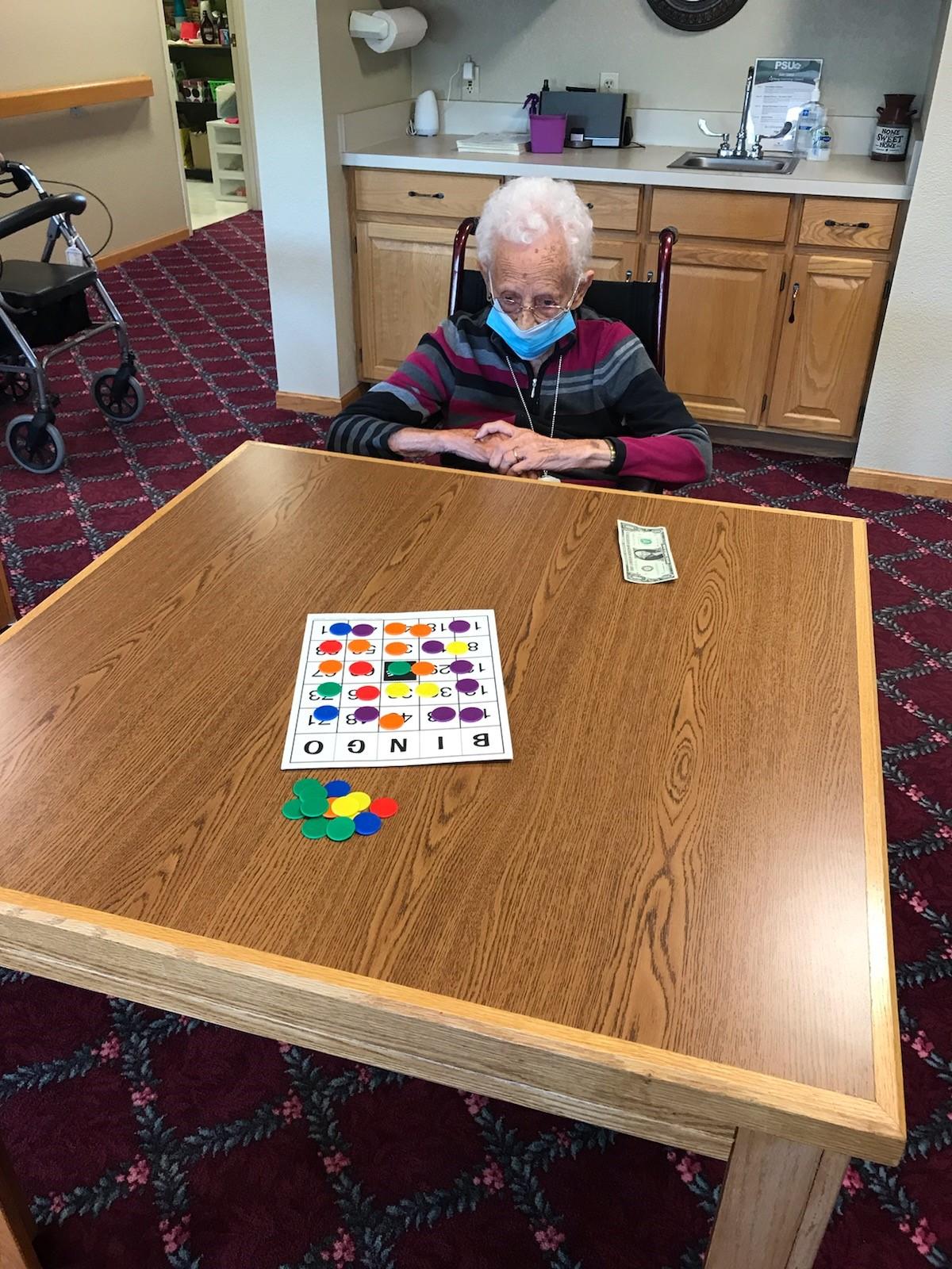 100 Year Old Stella wins coverall BINGO!
