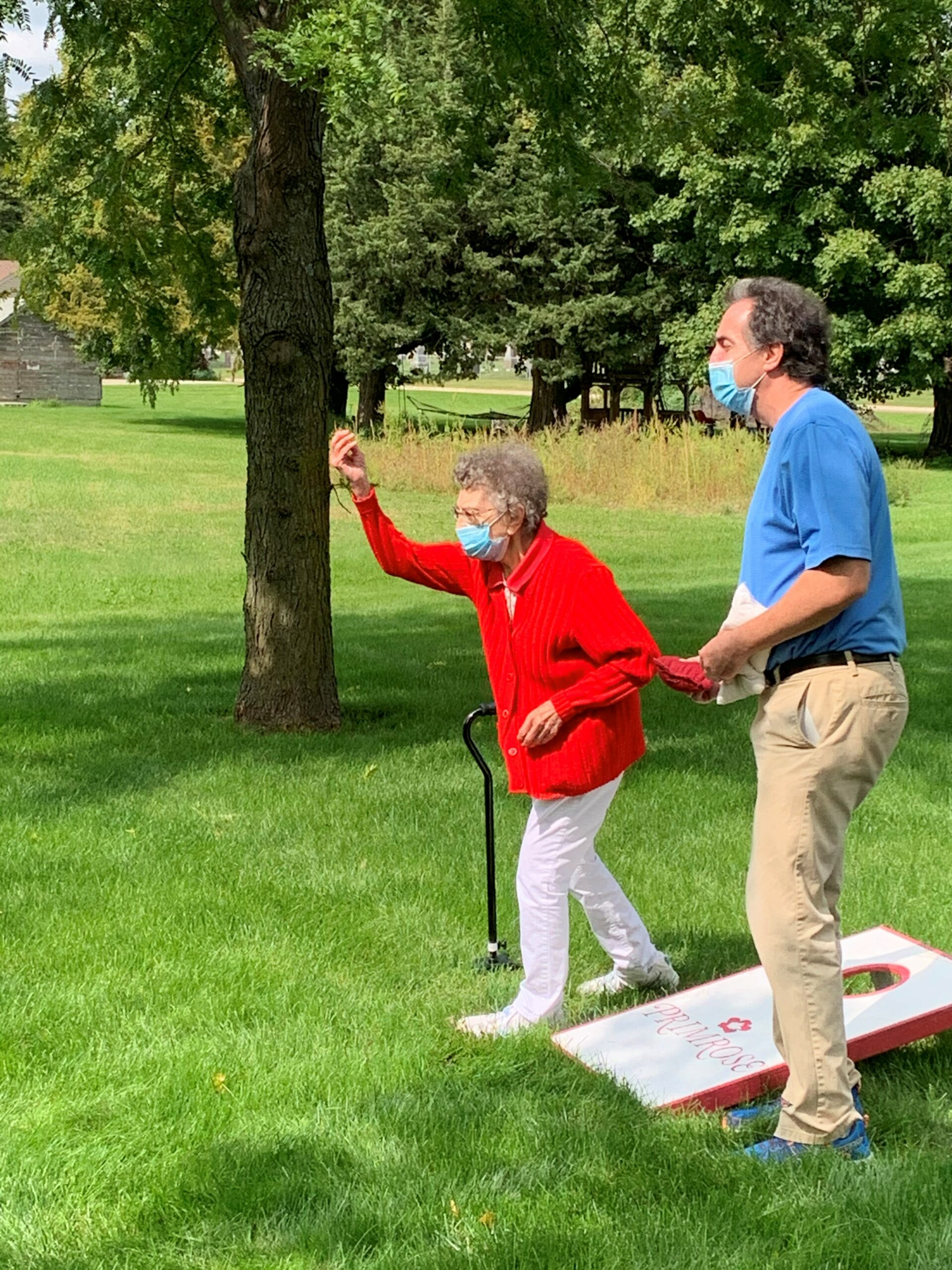 Edith shows her competitive side challenging our LEC, Steve, to a fierce game of cornhole!