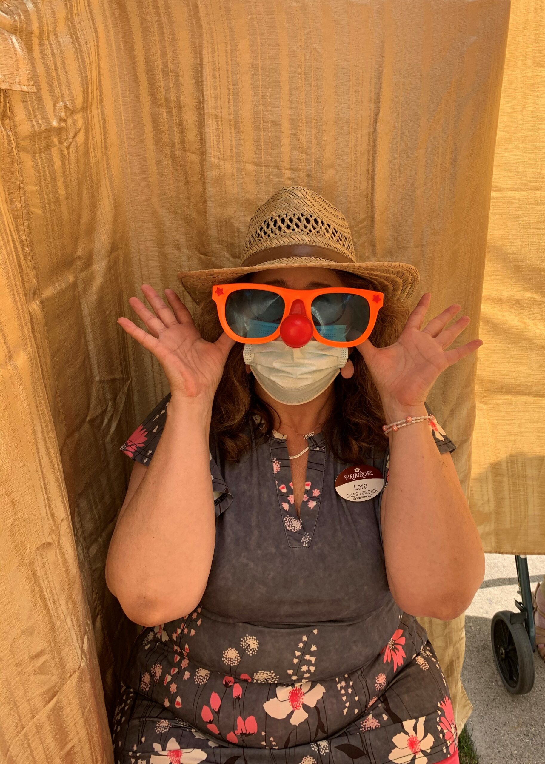 Our own crazy clown, Director of Sales, Lora, hops in our photo booth for a quick pic!