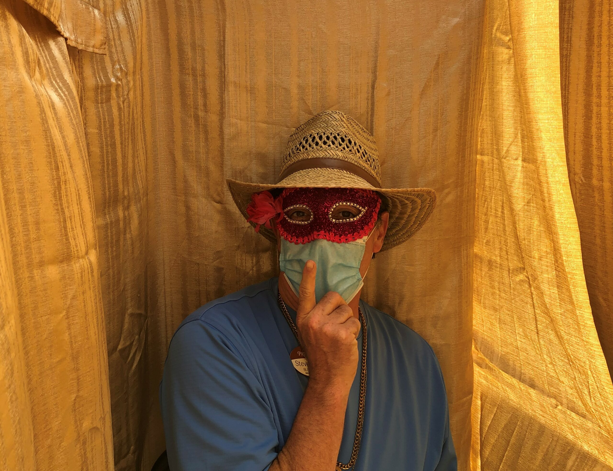 Our Life Enrichment Coordinator, Steve, gets in on the photo booth fun!