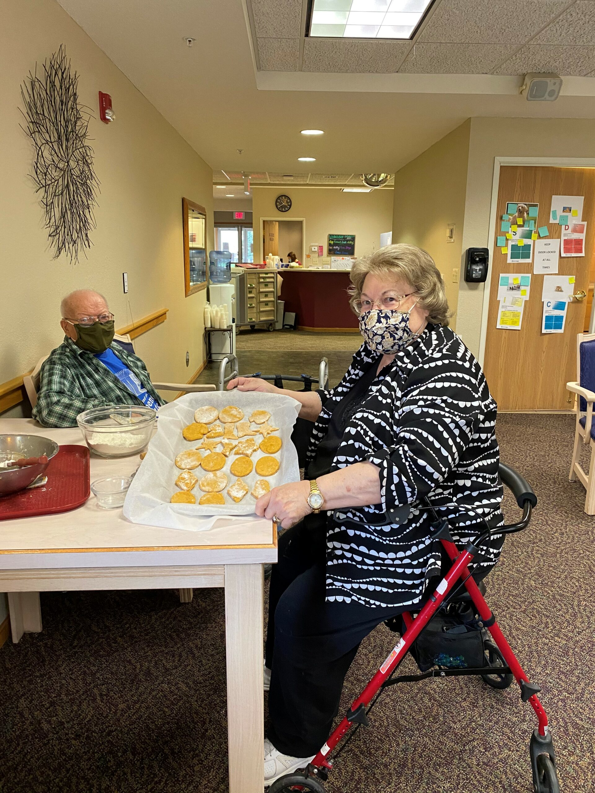 Richard & Mary mix, roll & cut out dog treats to be donated to our local animal shelter!