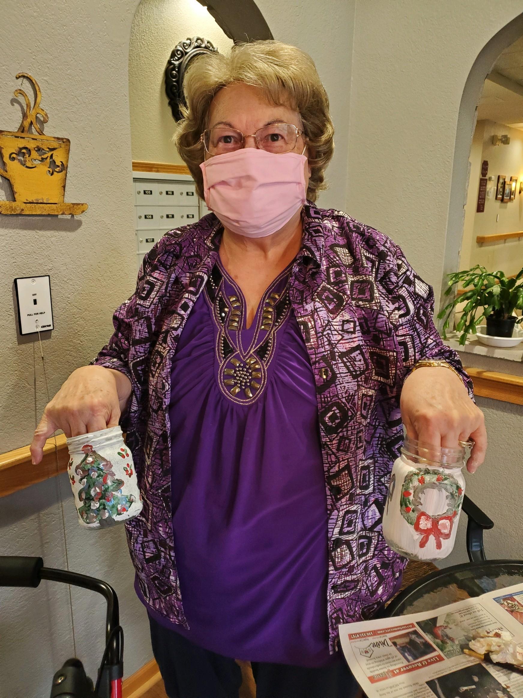 Mary painting Mason jars for National Mason Jar day!