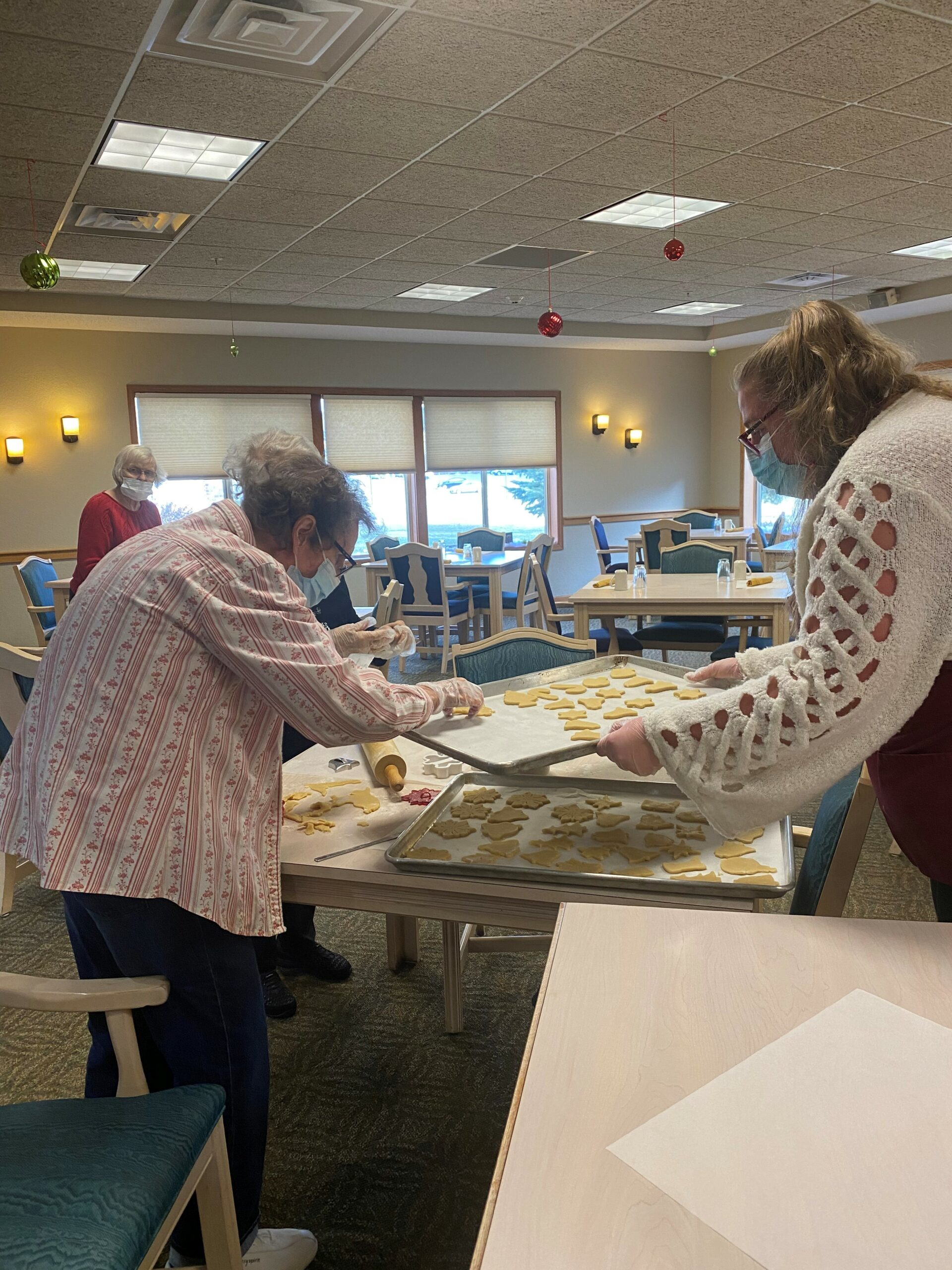 Jean, Norma & Dorie join Mary to roll, cut out and bake Christmas cookies!