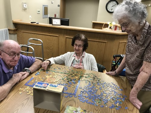 Residents working on puzzles.  Sometimes its a contest.