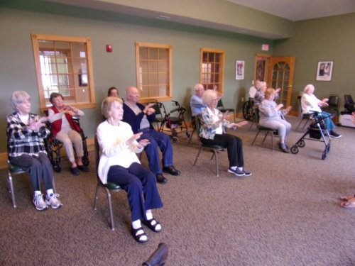 Dancing in our chairs to the oldies for exercise class.  Having lots of fun!